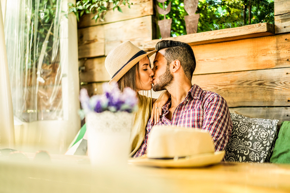 Happy travel couple having tender moments in bar restaurant - How To Keep A Scorpio Man Once You Get Him