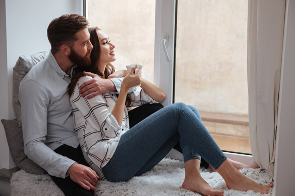 Loving couple sitting together and look at window - How to Get a Scorpio Man to Marry You