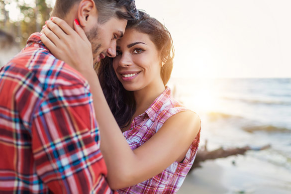 romantic young couple at the beach - How to Get a Scorpio Man to Marry You